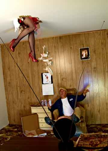 humorous photo of woman in fishnets falling through ceiling