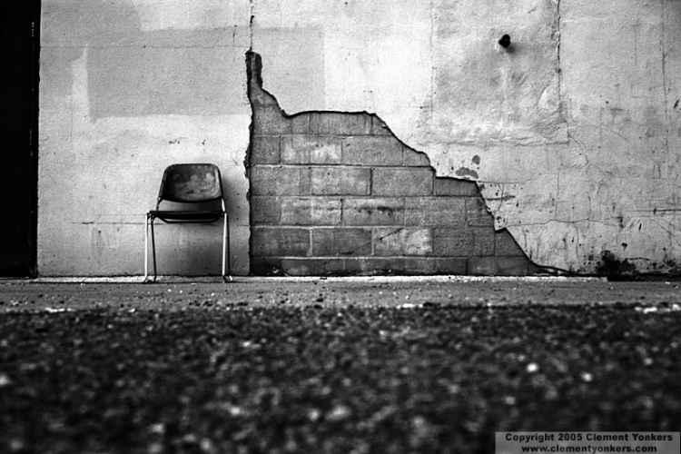 photo of chair against a wall B&W